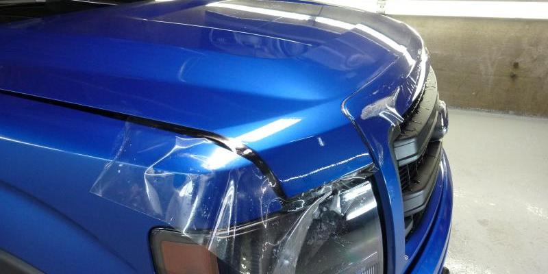 Blue Ford F-150 clear bra application