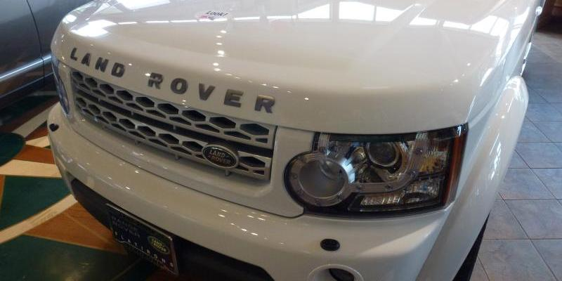 White Land Rover in the showroom