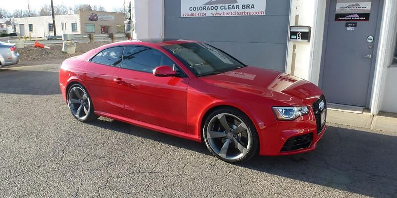 Red Audi RS5 in front of shop