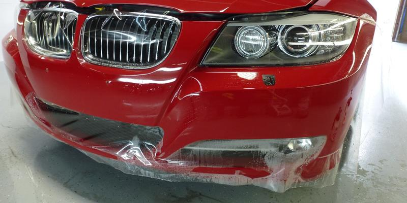 Red BMW 335i getting clear bra on front bumper
