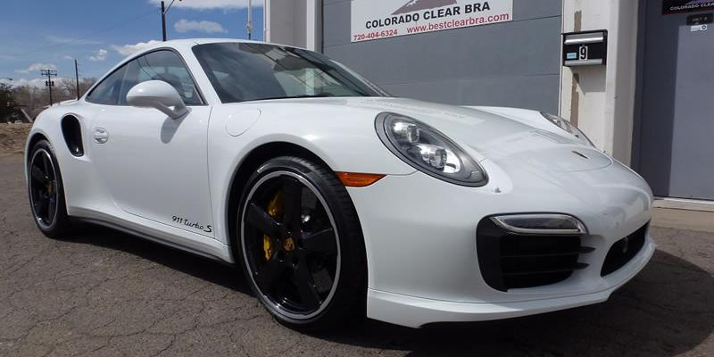 White Porsche 911 outside of shop